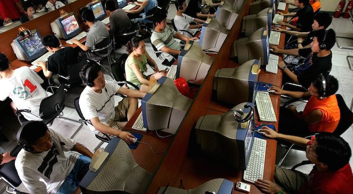 Chinese youth use computers at an Internet cafe in Beijing Saturday June 18, 2005.  China has the world's second-largest online population - 100 million - after the United States, but addiction to the Internet is increasing. The country's first government-approved clinic geared toward curing Internet addicts, has treated more than 300 addicts since opening last October.  (AP Photo/Greg Baker)