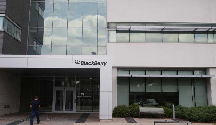 A man enters the BlackBerry Ltd. headquarters building in Waterloo, Ontario, Canada, on Wednesday, July 6, 2016. BlackBerry will no longer manufacture the BlackBerry Classic, a beloved, updated model of the original that made the company a smartphone leader before Apple Inc. and Samsung Electronics Co. dethroned it. Photographer: Cole Burston/Bloomberg via Getty Images